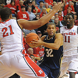 Notre Dame Fighting Irish guard Joey Brooks (32) drives the lane against Rutgers Scarlet Knights forward/center Austin Johnson (21) during Big East NCAA action during Rutgers' 65-58 victory over Notre Dame at the Louis Brown Athletic Center in Piscataway, N.J.