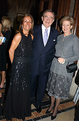 Left to right, LOULA CHANDRIS chairman of the ball, KING CONSTANTINE OF GREECE and  QUEEN ANNE-MARIE OF GREECE at The Magic of Winter ball in aid of the charity KIDS held at The Royal Courts of Justice, London on 2nd Ferbruary 2005.<br />