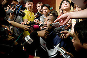 Kobe   Bryant, basketball player on the U.S. Olympic team, is surrounded by the media at a news conference in Beijing, China, on Friday, Aug. 8, 2008.