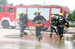 July 27, 2018 - Pinglian, Pinglian, China - Pingliang, CHINA-Firefighters receive summer training in Pingliang, northwest China's Gansu Province. (Credit Image: © SIPA Asia via ZUMA Wire)