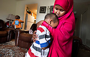 HOPKINS, MN - APRIL, 27: Suaado Salah comforts her son Luqman, 3, at their apartment in Hopkins, Minn., Thursday April 27, 2017. Luqman and his 18-month-old sister got the measles during the current outbreak in Minneapolis and are now fully healing at home. Brother Abdullahi, 5, left, did not get sick and has now been vaccinated. Salah had previously refused the MMR shot for them because of rumors that it caused autism. She has since changed her mind and is upset that the connection is still being touted by anti-vaxxers.