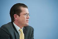 12 APR 2010, BERLIN/GERMANY:<br /> Karl-Theodor zu Guttenberg, CDU, Bundesverteidigungsminister, waehrend einer Pressekonferenz zur Vorstellung der Strukturkommission der Bundeswehr, Bundespressekonferenz<br /> IMAGE: 20100412-01-007