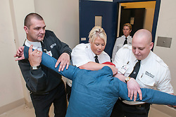 Prisoner being restrained by court staff in Southampton Crown Court