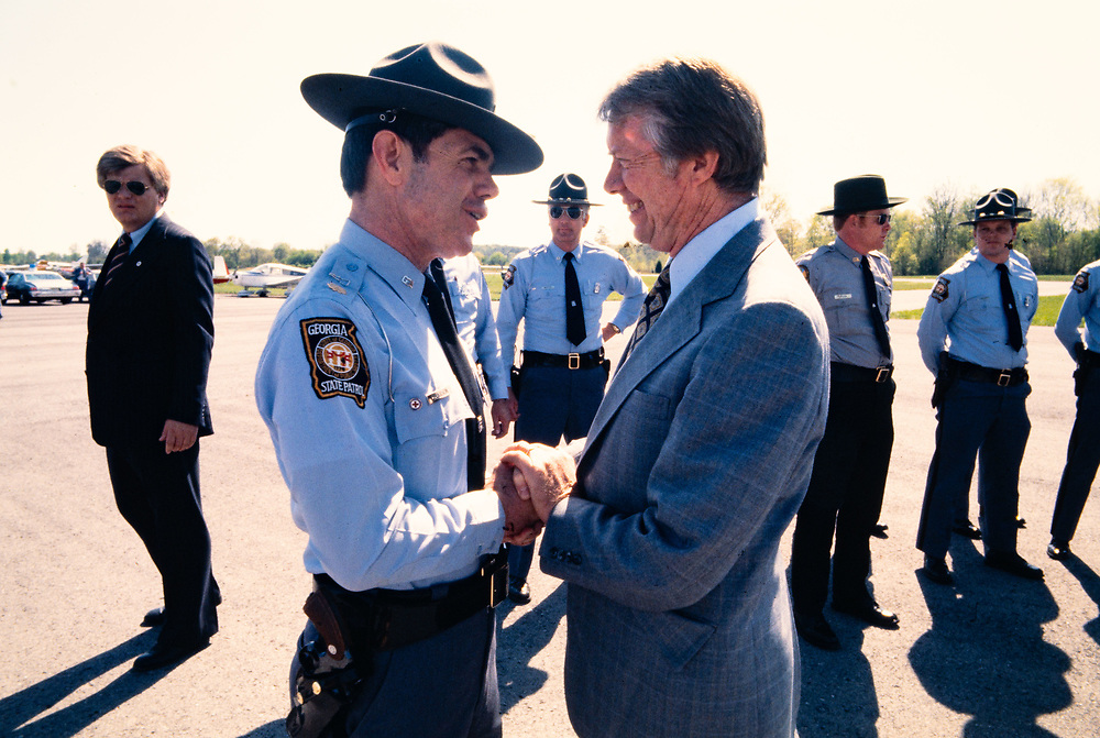 President Jimmy Carter and Georgia State Patrol Colonel Hugh Hardison at an airport in Calhoun, Georgia.