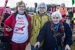 London, UK. 8 December, 2019. Sipson residents and longstanding campaigners against Heathrow expansion Christine Taylor (l), Jane Taylor (c) and Sheila Taylor (r) join climate activists from Extinction Rebellion outside Heathrow airport for a Bikes Against Bulldozers protest against Heathrow expansion and the greenwashing of climate commitments by political parties. The protest took the form of a Critical Mass bicycle ride from Hyde Park followed by a lie-in in front of a bulldozer to which Boris Johnson and John McDonnell were invited in order to fulfil their pledge of lying down in front of bulldozers to be used for Heathrow expansion.