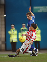 Photo. Leigh Quinnell.  Millwall v Stoke City Coca Cola championship. 19/02/2005. Stokes Lewis Buxton stops Millwalls Scott Dobie putting over a cross