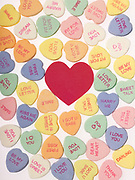 Assortment of Valentine's Day heart candy with a large red heart in the center