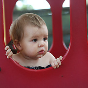 A fourteen month old baby girl in a playground setting during play. Photo Tim Clayton