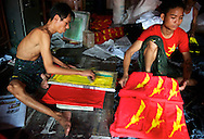 As a consequence of the end of the ban, a large amount of NLD merchandise is printed. Yangon, Mynamar. 2012