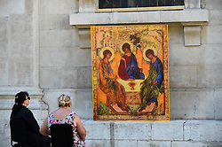© Licensed to London News Pictures. 25/06/2020. LONDON, UK.  Sally, a priest of the church, (L) and Carol, a congregation member, sit in the new outdoor Prayer Garden in the courtyard of St Martin-in-the-Fields, Trafalgar Square, where all are welcome to meditate, pray and discover peace and stillness at the heart of London.  The UK government has relaxed coronavirus pandemic lockdown restrictions allowing churches and other places of worship to open for private prayer from 15 June and, in the latest change, collective worship and communal prayer will be allowed from 4 July.  Currently, many churches are offering online services to their congregations. Photo credit: Stephen Chung/LNP