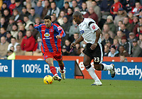 Photo: Kevin Poolman.<br />Derby County v Crystal Palace. Coca Cola Championship. 16/12/2006. Jobi McAnuff of Palace looks for a way past Darren Moore of Derby.
