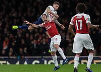 Football - 2018 / 2019 EFL Carabao Cup (League Cup) - Quarter-Final: Arsenal vs. Tottenham Hotspur<br /> <br /> Kieran Trippier (Tottenham FC)  climbs over the back of Nacho Monreal (Arsenal FC) at The Emirates.<br /> <br /> COLORSPORT/DANIEL BEARHAM