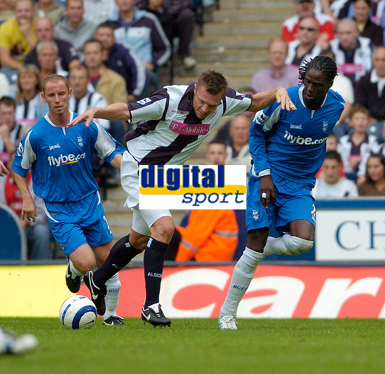 Photo: Leigh Quinnell.<br /> West Brom v Birmingham City. The Barclays Premiership. Geoff Horsfield works his way past Birminghams Mario Melchiot and Nicky Butt<br /> 27/08/2005.