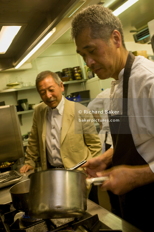 Japanese entrepreneur, Tetsuro Hama with sushi chef and old friend, Kaoru Yamamoto at his 'So' restaurant business, Soho, London. <br /> <br /> From the chapter entitled 'The Price of Happiness' and from the book 'Risk Wise: Nine Everyday Adventures' by Polly Morland (Allianz, The School of Life, Profile Books, 2015).