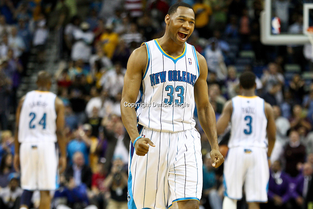 April 6, 2011; New Orleans, LA, USA; New Orleans Hornets shooting guard Willie Green (33) reacts in the final second of the fourth quarter against the Houston Rockets at the New Orleans Arena. The Hornets defeated the Rockets 101-93 and clinched a playoff spot with the victory.   Mandatory Credit: Derick E. Hingle-US PRESSWIRE