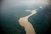 An aerial view over a large river in northern Laos.