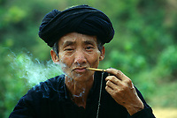 """Ethnic minority man smoking a pipe, Northern Vietnam<br /> Available as Fine Art Print in the following sizes:<br /> 08""""x12"""" US$ 100.00<br /> 10""""x15"""" US$ 150.00<br /> 12""""x18"""" US$ 200.00<br /> 16""""x24"""" US$ 300.00<br /> 20""""x30"""" US$ 500.00"""
