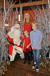 HEIDI BISHOP and her children MAX BISHOP and SKYE BISHOP at a party hosted by Camila Batmanghelidjh for Kids Company held at The Ivy Market Grill, 1 Henrietta Street, Covent Garden, London on 23rd November 2014.