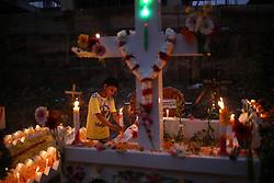 November 2, 2018 - Dhaka, Bangladesh - Dhaka, Bangladesh. A Bangladeshi Christian boy offers prayers by the grave of a relative during the All Soul's Day at a graveyard in Dhaka, Bangladesh on November 2, 2018. (Credit Image: © Rehman Asad/NurPhoto via ZUMA Press)