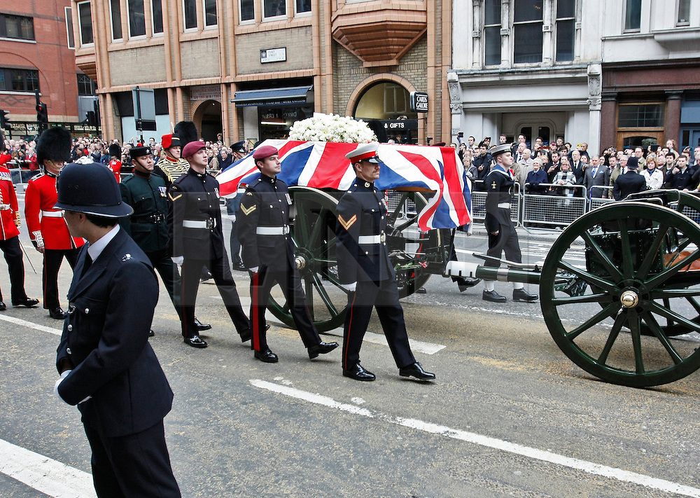 © Licensed to London News Pictures. 17/04/2013. London, U.K..The Gun carriage carries Baroness Thatcher Coffin along  Fleet St. The ceremonial Funeral with military honours of Baroness Thatcher , the first female Prime Minister of United Kingdom (today 17/4/2013), who died last week of a stroke..Photo credit : Rich Bowen/LNP