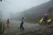 In the former British railway village of Paranapiacaba, it is said that football was introduced to Brazil by Charles Miller. Here boys play football in the low lying fog that regularly blankets the village.