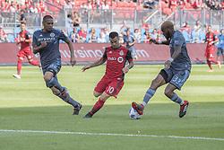 August 12, 2018 - Toronto, Ontario, Canada - MLS Game at BMO Field 2-3 New York City. IN PICTURE: SEBASTIAN GIOVINCO, SEBASTIEN IBEAGHA,ALEXANDER CALLENS (Credit Image: © Angel Marchini via ZUMA Wire)