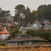 Houses crowd the shoreline cliffs in Montara, California, just south of San Francisco.