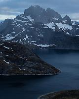 Mountain landscape rising above lake Solbjørnvatn, Moskenesøy, Lofoten Islands, Norway