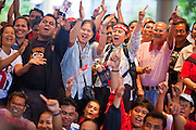 03 JULY 2011 - BANGKOK, THAILAND:    People in Bangkok celebrate news that the Pheu Thai party and Yingluck Shinawatra won the Thai election Sunday.  Yingluck Shinawatra and the Pheu Thai Party scored a massive landslide win in the Thai election Sunday. Pheu That is estimated to have won more than 300 seats in Thailand 500 seat parliament, so they won an absolute majority and could govern without having to form a coalition with minor parties. Pheu Thai is the latest incarnation of deposed former Prime Minister Thaksin Shinawatra's political party. Yingluck is his youngest sister. Many observers expect legal challenges to the Pheu Thai victory and the election does not completely resolve Thailand's difficult political history of the last five years.    PHOTO BY JACK KURTZ