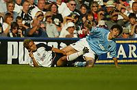 Photo. Aidan Ellis.<br />Fulham v Manchester City.<br />Barclaycard Premiership.<br />20/09/2003.<br />Fulham's Junichi Inamoto and City's Jihai Sun