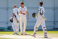 Adam Lyth bumps elbows with Gavin Griffiths at the end of  the Bob Willis Trophy match between Yorkshire County Cricket Club and Leicestershire County Cricket Club at Emerald Headingley Stadium, Leeds, United Kingdom on 9 September 2020.