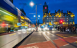 Night view of Princes Street in Edinburgh with tram and traffic on long exposure in Scotland, United Kingdom.