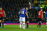 Gareth Barry of Everton receives a yellow card from referee Michael Oliver. Premier league match, Everton v Manchester United at Goodison Park in Liverpool, Merseyside on Sunday 4th December 2016.<br /> pic by Chris Stading, Andrew Orchard sports photography.