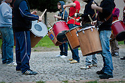 Cropped image of the drummers of Assisi rehearsing for the Calendimaggio festival to commemorate Holy Week. Assisi, Umbria, Italy.