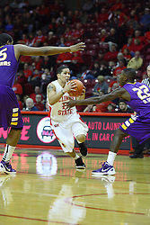 19 November 2011:  Nic Moore cuts between Marvon Williams and Damarius Smith during an NCAA mens basketball game between the Lipscomb Bison and the Illinois State Redbirds in Redbird Arena, Normal IL