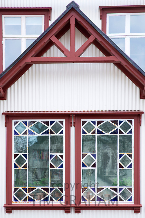 Traditional typical painted leaded light glass window - leaded lights - in old town area of capital city Reykjavik, Iceland
