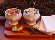 Homemade chicken broth used two ways - red curry chicken soup and Asian noodle soup, prepared by Chef Kirsten Dixon of Winterlake Lodge, Alaska.