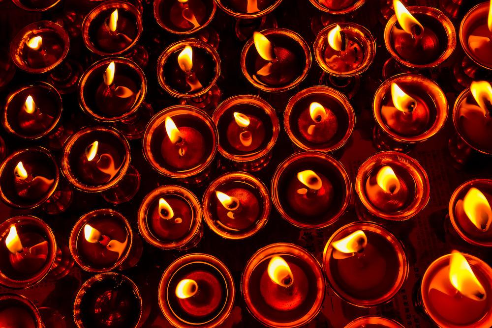 Yak butter lamps in the Chapel of Sakya, Palcho Monastery, Gyangze, Tibet (Xizang), China