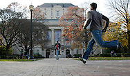 (ENROLL osuenr SHILLING 11/10/05) Ohio State students cross in front of the Main Library. (Photos for the Dispatch by Will Shilling)  Ohio State University campus libraries