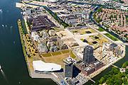 Nederland, Noord-Holland, Amsterdam-Noord, 29-06-2018; Buiksloterham,  Overhoeks, voormalig Shell Research-terrein. Huisvest nu onder andere filmmuseum EYE (EYE Film Instituut Nederland), de toren Overhoeks, de A'DAM Lookout toren, Tolhuistuin, Oeverpark. Buiksloterkanaal.<br /> Overhoeks, a new city district on the IJ bank in Amsterdam-North.<br /> <br /> luchtfoto (toeslag op standard tarieven);<br /> aerial photo (additional fee required);<br /> copyright foto/photo Siebe Swart