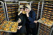 Kim Oster Holstein and Scott Holstein, co-presidents and founders, stand amid racks of freshly baked pretzels at Kim & Scott's Gourmet Pretzels in Chicago Jan. 21, 2004.