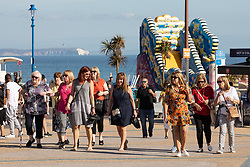 © Licensed to London News Pictures . 13/09/2019. Bournemouth, UK. People walk along the promenade by the beach in Bournemouth as a late summer heatwave brings high temperatures to the south coast of England . Photo credit: Joel Goodman/LNP
