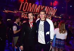 Richard Biedul and Toby Huntington-Whiteley during the Tommy Hilfiger Front row during London Fashion Week SS18 held at Roundhouse, Chalk Farm Rd, London. Picture Date: Tuesday 19 September. Photo credit should read: Ian West/PA Wire