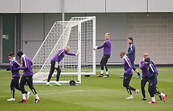 Manchester City's Joe Hart and Willy Caballero moves the goal posts during the training session at the Etihad Campus ahead of the UEFA Champions League second leg match against FC Barcelona - Photo mandatory by-line: Matt McNulty/JMP - Mobile: 07966 386802 - 17/03/2015 - SPORT - Football - Manchester - Etihad Campus - Barcelona v Manchester City - UEFA Champions League