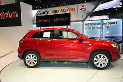 08  February 2013: 2013 Mitsubishi Outlander Sport ES 2wd 4 door Sport Utility Vehicle (SUV) automobile. Chicago Auto Show, Chicago Automobile Trade Association (CATA), McCormick Place, Chicago Illinois<br /> <br /> 2013 MITSUBISHI OUTLANDER SPORT: Heading into its third year of production, Mitsubishi's Outlander Sport compact crossover is currently the best-selling car in Mitsubishi Motors' North American model lineup. For 2013, the Outlander Sport receives a new grille, front fascia, fog lights, new side sills, redesigned bumpers and standard 18-inch alloy wheels on all trim levels. Powered by a 148 horsepower 2.0-liter four-cylinder engine equipped with Mitsubishi's advanced MIVEC variable valve-timing technology, the 2013 Outlander Sport garners an impressive EPA fuel mileage rating of 31 mpg highway. While a crisp-shifting five-speed manual transmission is included on the ES two-wheel model, a high-tech Continuously-Variable Transmission (CVT) with steering wheel-mounted paddle shifters is also available as is four-wheel drive. The Sport SE comes standard with the CVT and can be ordered with either two-wheel or driver-selected, electronically-controlled four-wheel drive systems. Fresh exterior paint colors -White Pearl and Quick Silver - join Laguna Blue, Labrador Black, Mercury Gray and Rally Red. With composed handling, a comfortable ride and roomy seating for five-adults, the sport cabin includes new fabrics, chrome accents, noise reduction and improved high-performance speakers. When rear seating is folded flat, the Outlander Sport offers up to 49.5 cubic feet of cargo carrying capacity. Among the premium options is a panoramic glass roof, 40GB HDD navigation with music server and real-time traffic, and rearview camera system. Produced in the Normal, IL facility, the Outlander Sport is not only supplied to Mitsubishi dealers in the US, but also shipped to foreign markets.