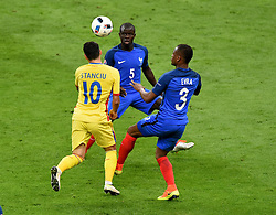 Nicolae Stanciu of Romania is fouled by Patrice Evra of France  to win a penalty  - Mandatory by-line: Joe Meredith/JMP - 10/06/2016 - FOOTBALL - Stade de France - Paris, France - France v Romania - UEFA European Championship Group A
