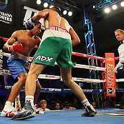 ORLANDO, FL - OCTOBER 04:  Felix Verdejo of Puerto Rico (L) sets up a right hand that knocks out Sergio Villanueva of Mexico in the third round of their professional lightweight boxing match at the Bahía Shriners Auditorium & Events Center on October 4, 2014 in Orlando, Florida. (Photo by Alex Menendez/Getty Images) *** Local Caption *** Felix Verdejo; Sergio Villanueva