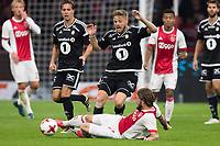 Fotball , 17. august k play-off Europa League , Ajax - Rosenborg BK ,  UEFA , <br /> Rosenborg BK speler Fredrik Midtsjo  in duel met Ajax speler Lasse Schone<br /> <br /> Norway only