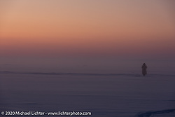 Michael Lichter walking on Lake Baikal as the sun sets after the Baikal Mile Ice Speed Festival. Maksimiha, Siberia, Russia. Monday, March 2, 2020. Photography ©2020 Sean Lichter.