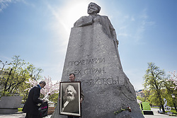 May 5, 2018 - Moscow, Moscow, Russia - Man holds a huge photo of Karl Marx under his statue during the celebrations of 200th anniversary of his birth in Moscow. (Credit Image: © Celestino Arce via ZUMA Wire)
